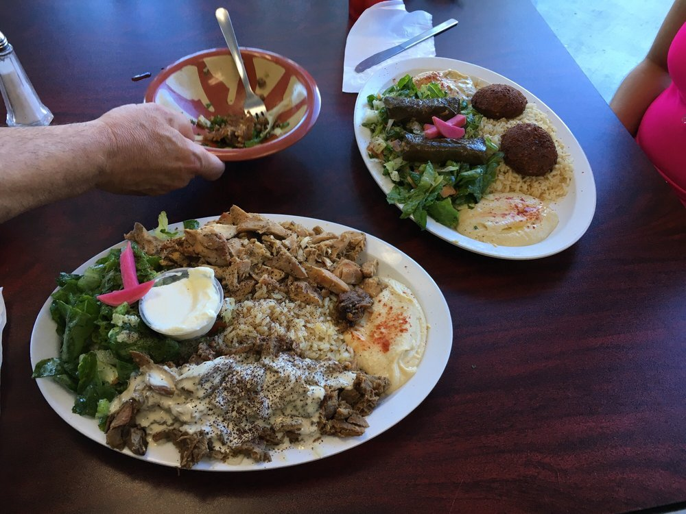 Vegetarian combo plate top right and shawarma mix plate for Alinas lebanese cuisine