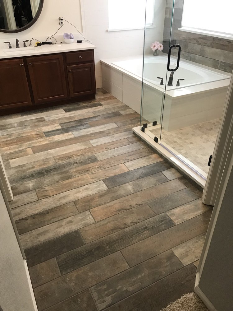 Master Bathroom With Fo Wood Porcelain Tile Solid Countertops And
