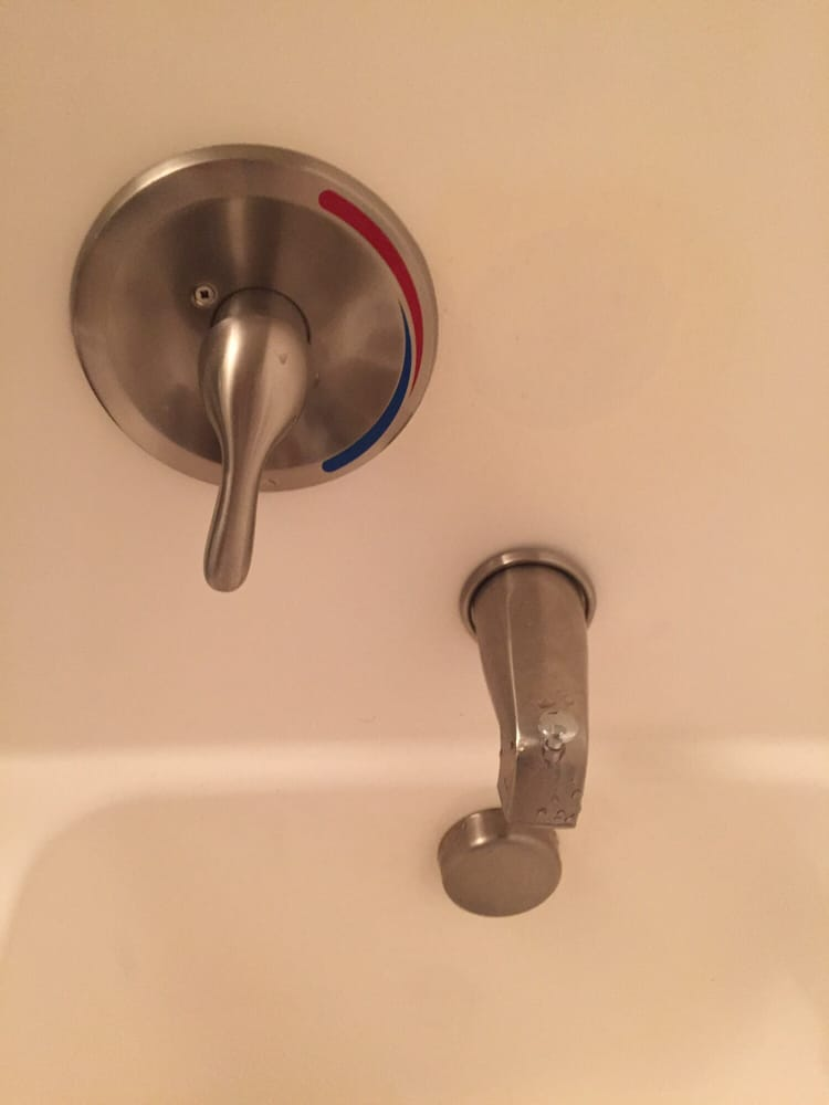 Tub faucets don\'t line up, and the faucet is falling off tub (no ...