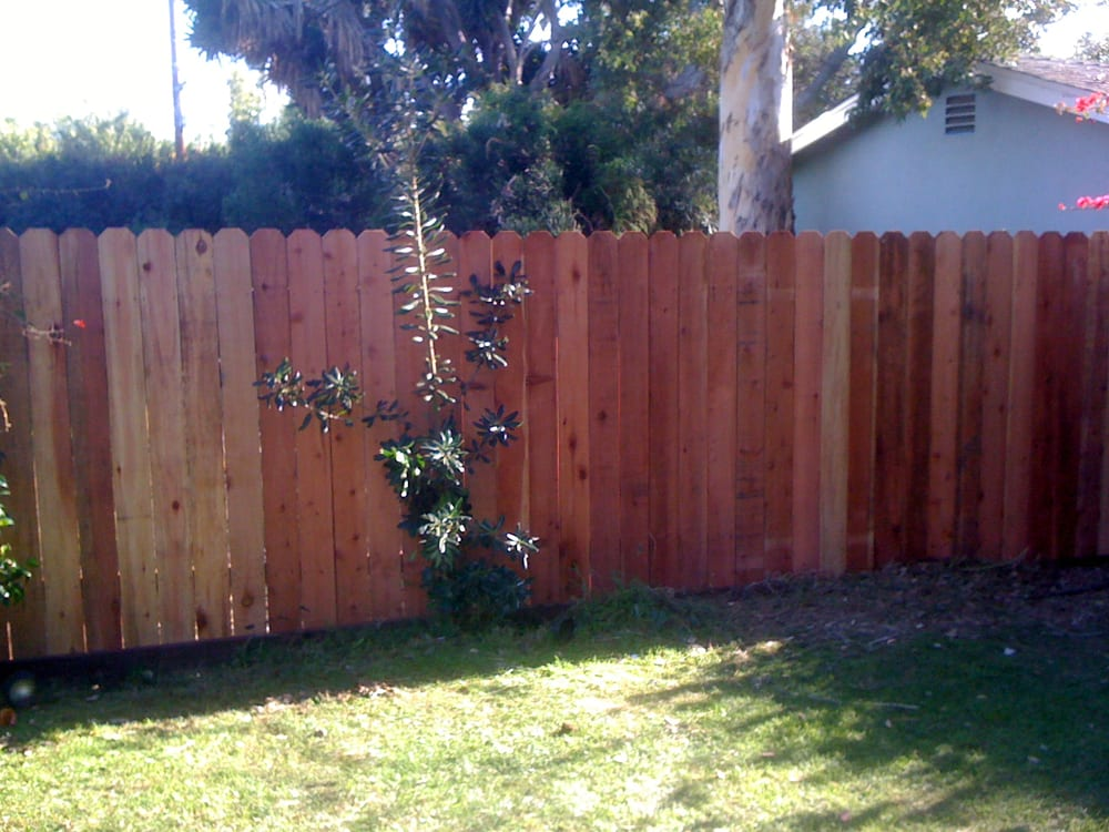 Set new posts in concrete  New 2x4 rails and new redwood dogear