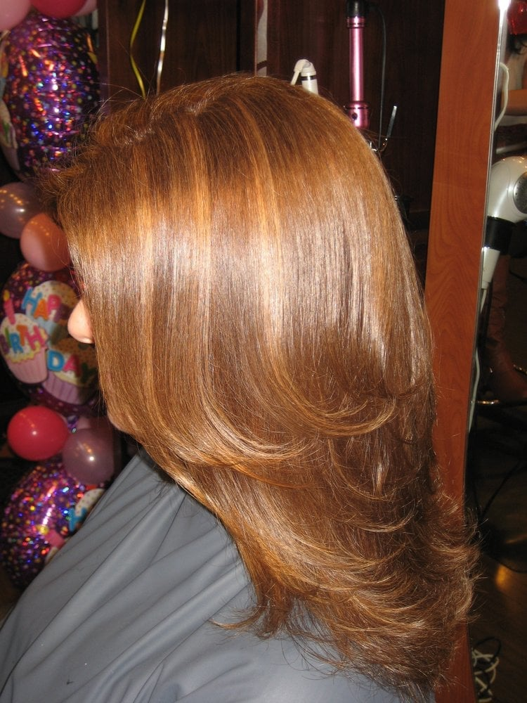 Elena Has Been Sun Kissed With A Golden Copper Highlight Over Her