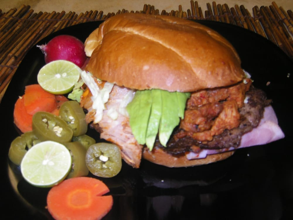 Delicious TORTA CUBANA.... comes with carnitas, chorizo ...