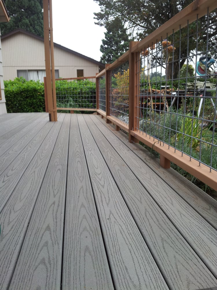 New composite deck with cedar railing and welded wire in for Building a composite deck