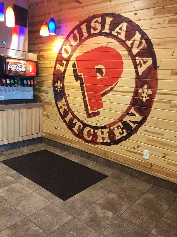 Popeyes Louisiana Kitchen Logo nice big logo on the wallthe clean drink station - yelp