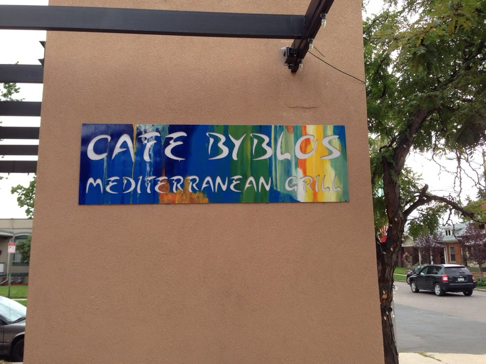 Photo of Cafe Byblos Mediterranean Grill - Denver, CO, United States. Sign on the wall!