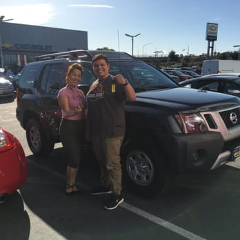 Xang proudly handing me the keys to my new (to me) 2014 Xterra!