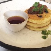 ... - Paris, France. Blueberry pancakes with rhubarb jam and maple syrup