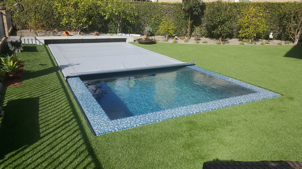 Automatic pool safety cover on a perimeter overflow pool - Electric swimming pool covers cost ...