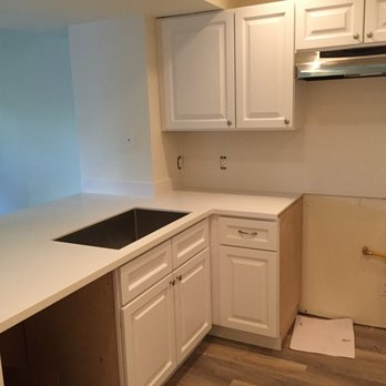 Solid Surface kitchen countertops with a full backsplash - Yelp
