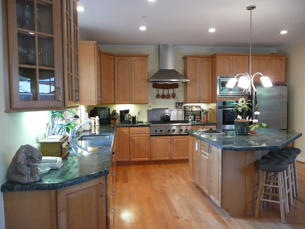 Kitchen with maple cabinets, granite counter tops and red ... on Granite Countertops With Maple Cabinets  id=85238