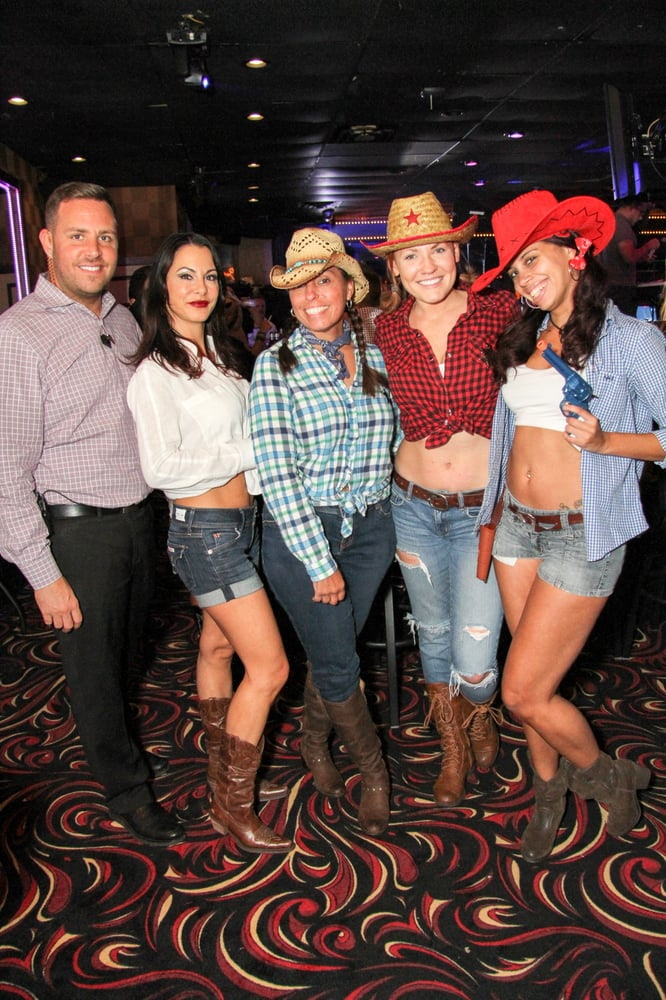 Staff Having Fun At The Daisy Dukes And Cowboys Boots