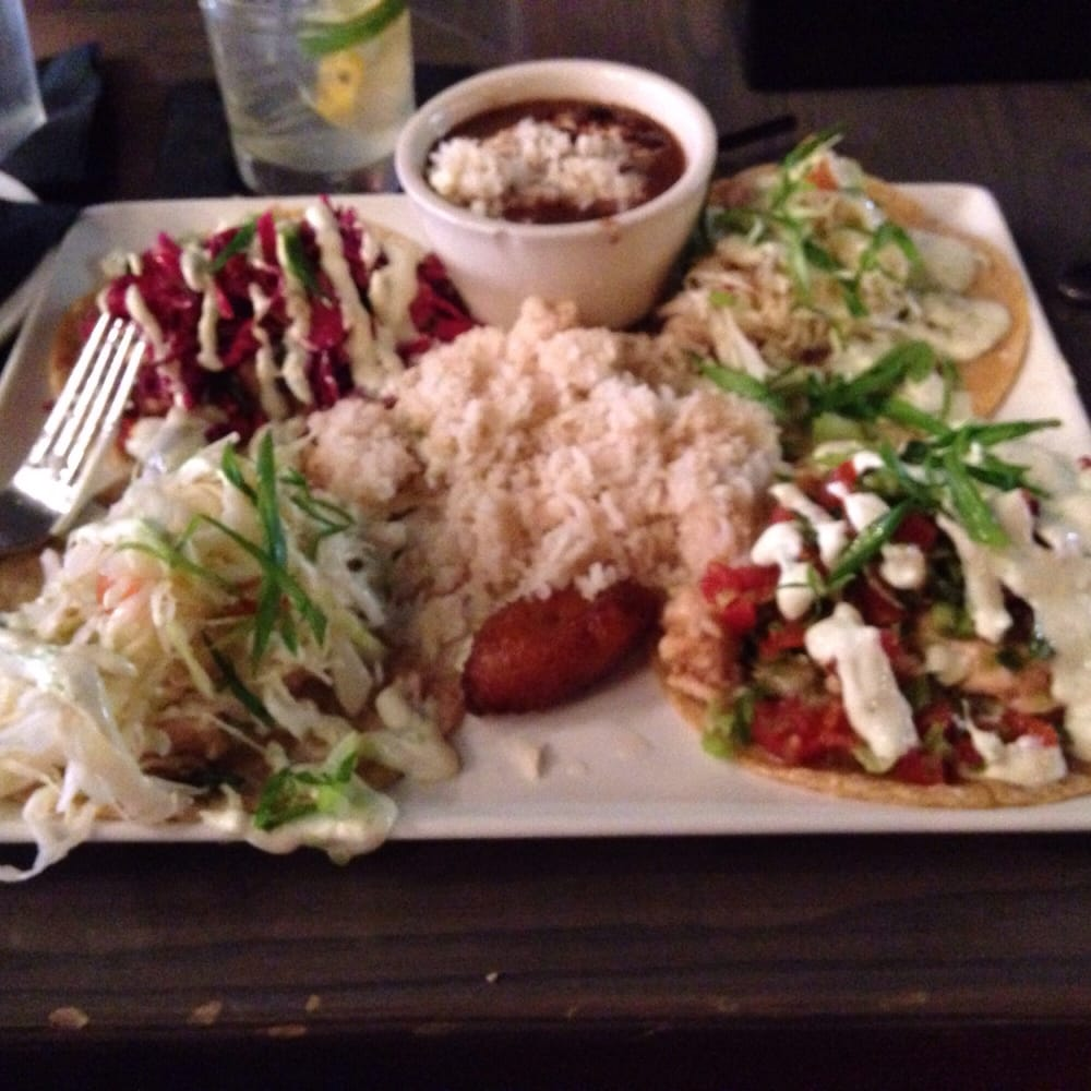 Tacos from around the world ask for the house made hot for Aura world fusion cuisine