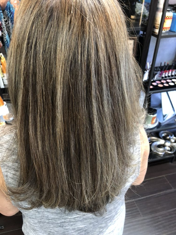 This Client Is Doing A Reverse Weave To Let Her Gray Hair Grow Out