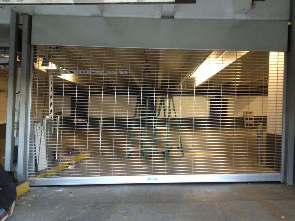 Aluminum grille rollup door yelp for United states aluminum corporation doors
