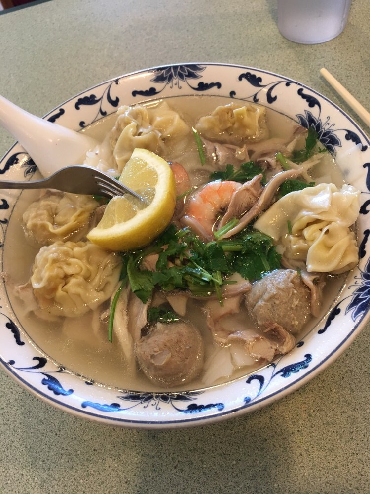 combination wonton noodle soup with a forked lemon  yelp