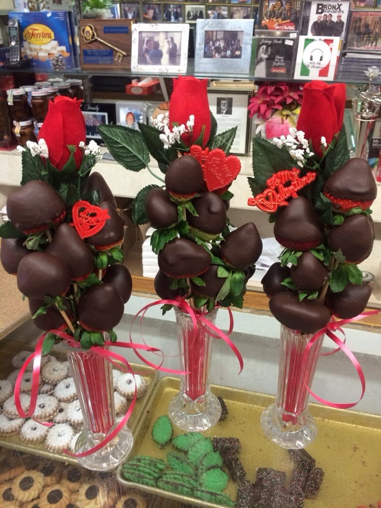 A Dozen Chocolate Covered Strawberries With A Single Artificial Rose