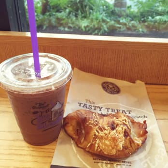 Coffee bean and tea leaf croissant with iced coffee.