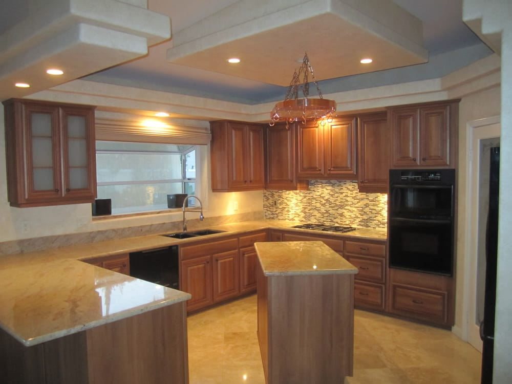 After Refacing Cabinets With Light Italian Walnut.