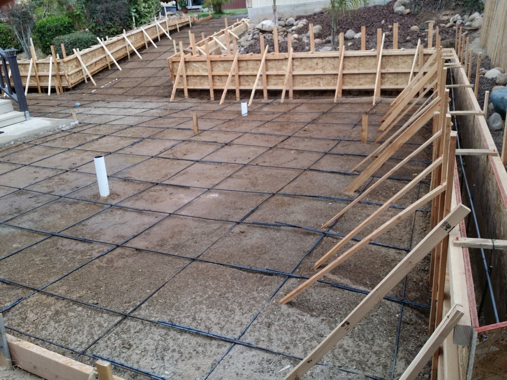 Set up poured in place retaining wall and slab for Monolithic pour foundation