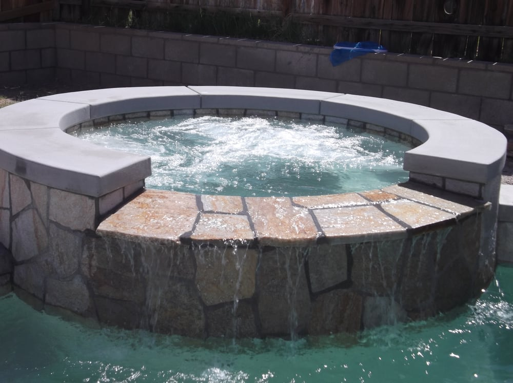 Spa With Natural Stone Drip Edge Spillway That American