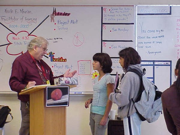 Brian teaching a science class about hypnotherapy at a ...