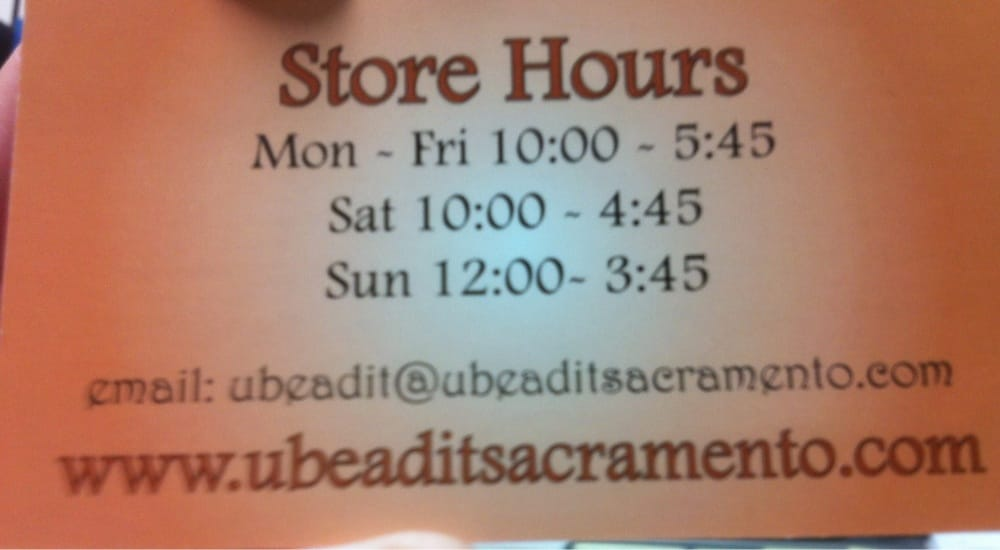 business card with store hours - Yelp