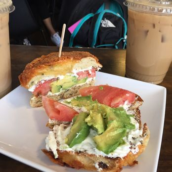 Avocado bagel with tomatoes w/ an iced vanilla latte and mint coffee ...