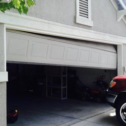 Garage door cowboys 23 foton garageportar 700 lavaca for Garage door repair austin yelp