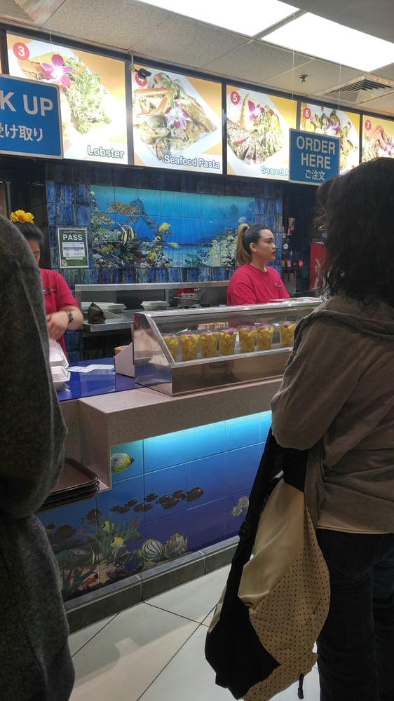 Horrible customer service from the cashier on the right yelp for Blue water fish market