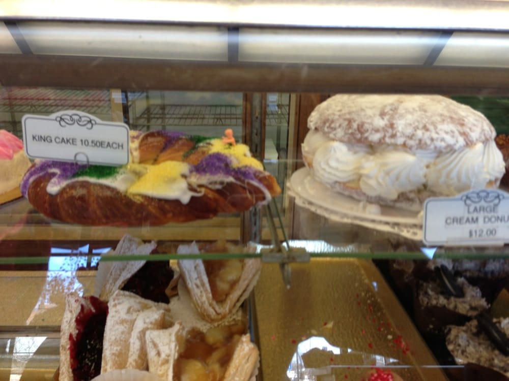 King Cake And Giant Creme Filled Doughnut It Just Doesn T