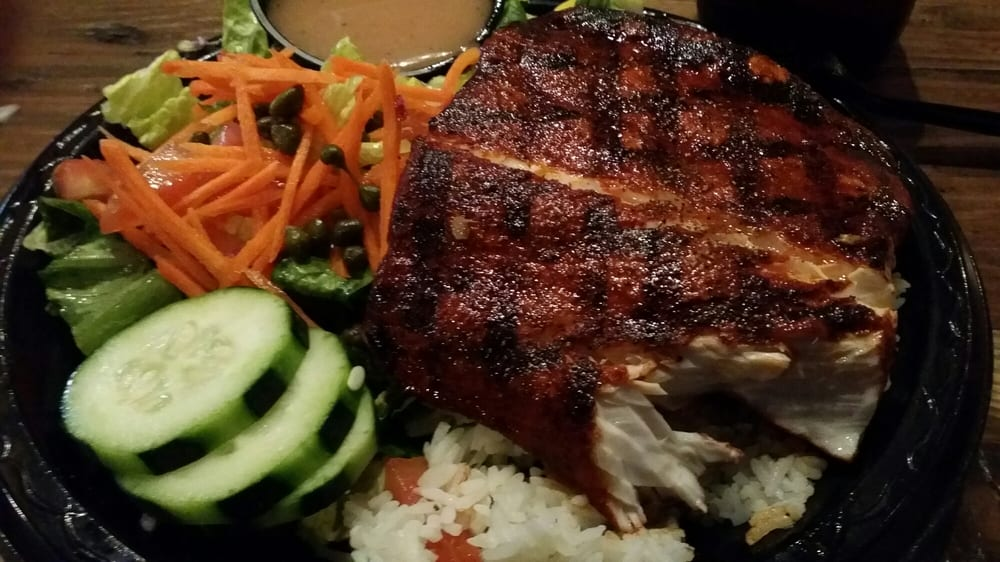 Blackened shark with white rice served with a side salad for Blue water fish market