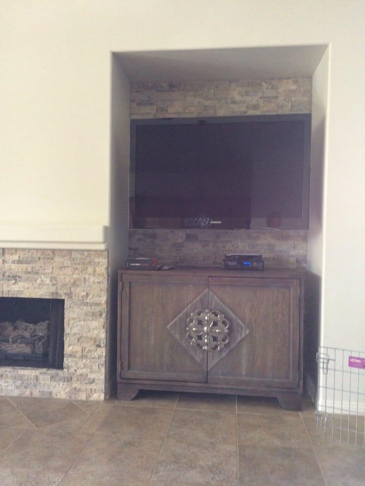 Stack stone in media niche w/same stone around fireplace face ...