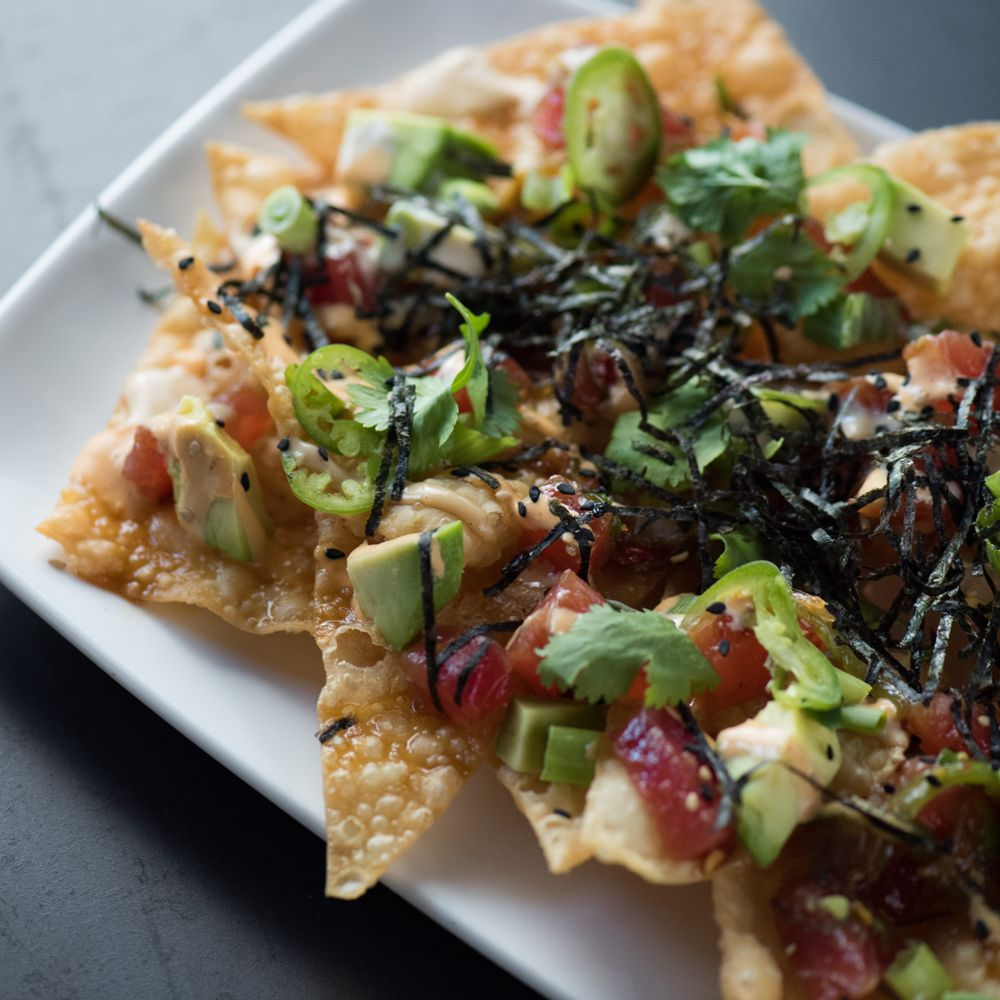 Satisfy your tastebuds with 1/2 off select appetizers, like our Poke Nachos, and all pizzas ...