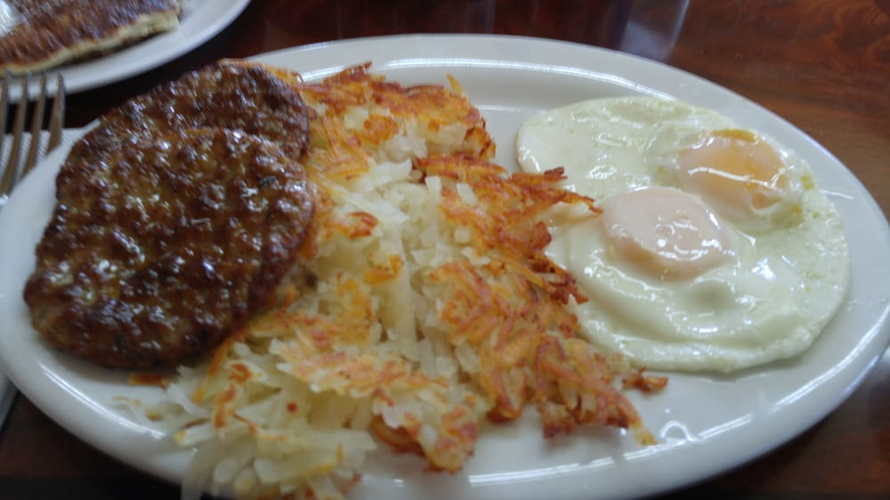 Breakfast plate, 2 eggs, 2 sausage patties and hash browns ...