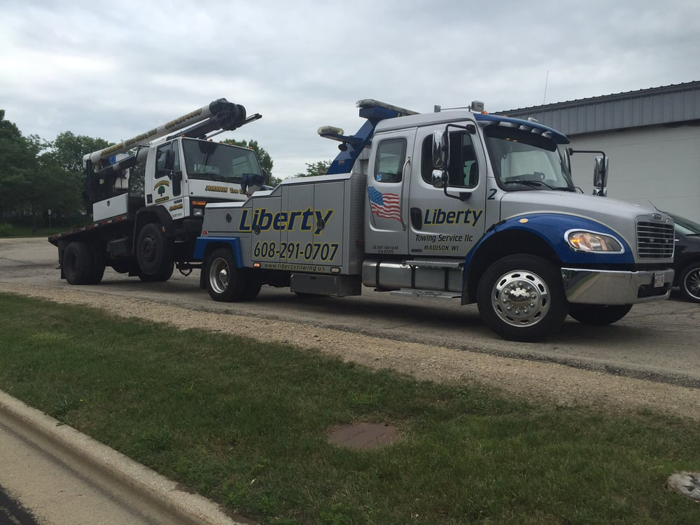 Liberty towing service 12 reviews roadside assistance for Roadside assistance mercedes benz phone number