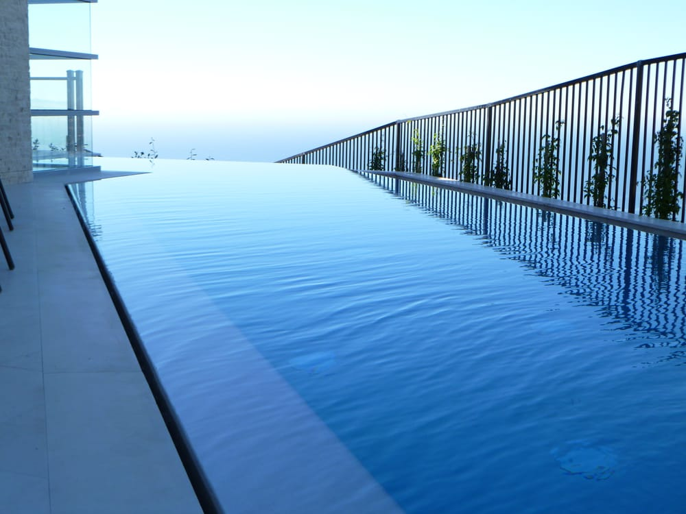 Infinity Edge Pool And Spa With Slot Perimeter Overflow To