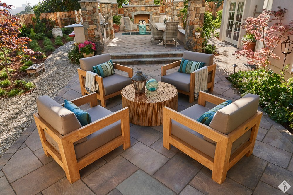 Luxurious Paver Patio And Full Outdoor Kitchen With Adjacent Dining