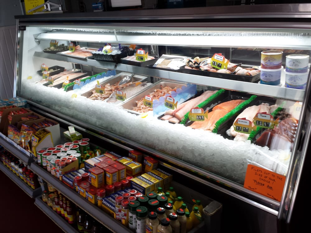 Fresh seafood display constantly changing with beautiful for Fresh fish market near me