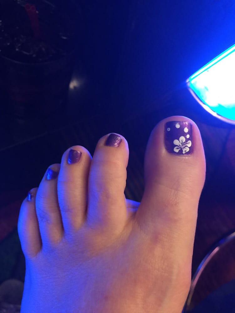photo of bit of heaven kingman az united states purple toenails with