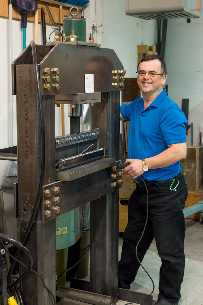 Donald Dawson Owner With A Hydraulic Forge Press That