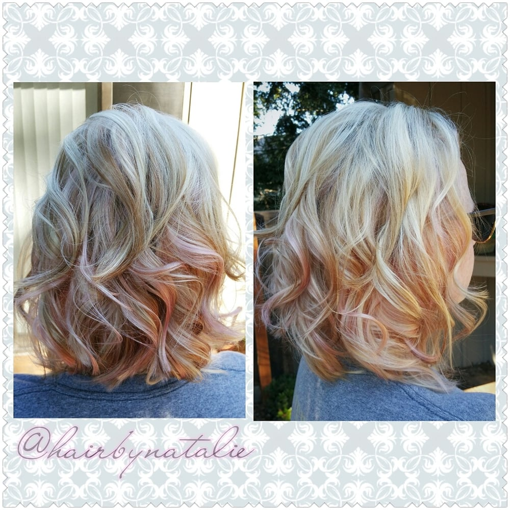 Layered Bob Haircut With Light Pink Color Slices Underneath Styled