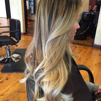 High contrast Balayage highlight blending dark roots into