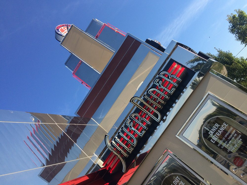 Love the neon and clock tower! - Yelp