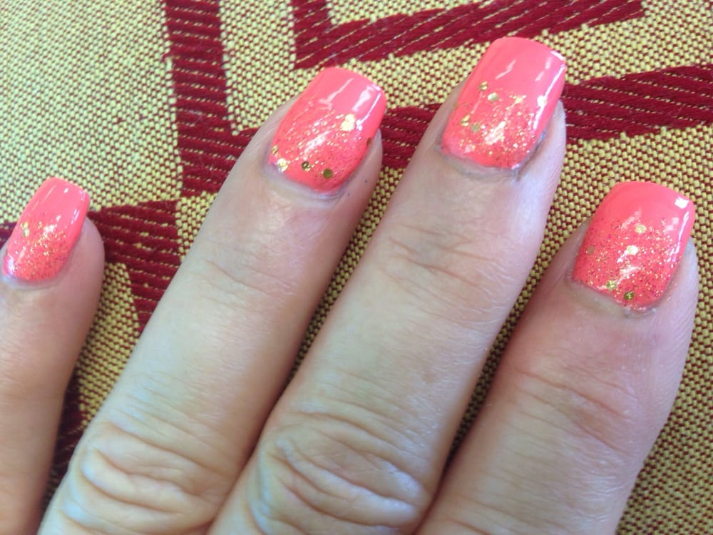 Love my new spring nail color. A corral pink with gold flecks half ...