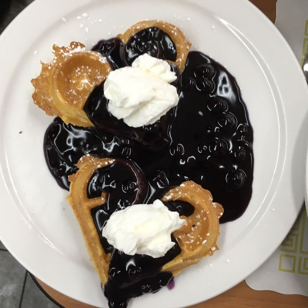 Belgian Waffles With Homemade Blueberry Sauce. Yum!