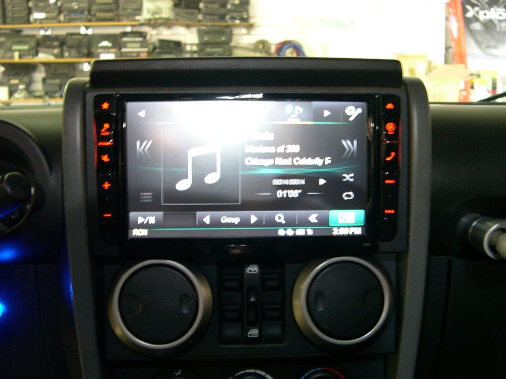 """Types Of Trailer Hitches >> Alpine 9"""" in dash customized in a 2010 Jeep Wrangler ..."""