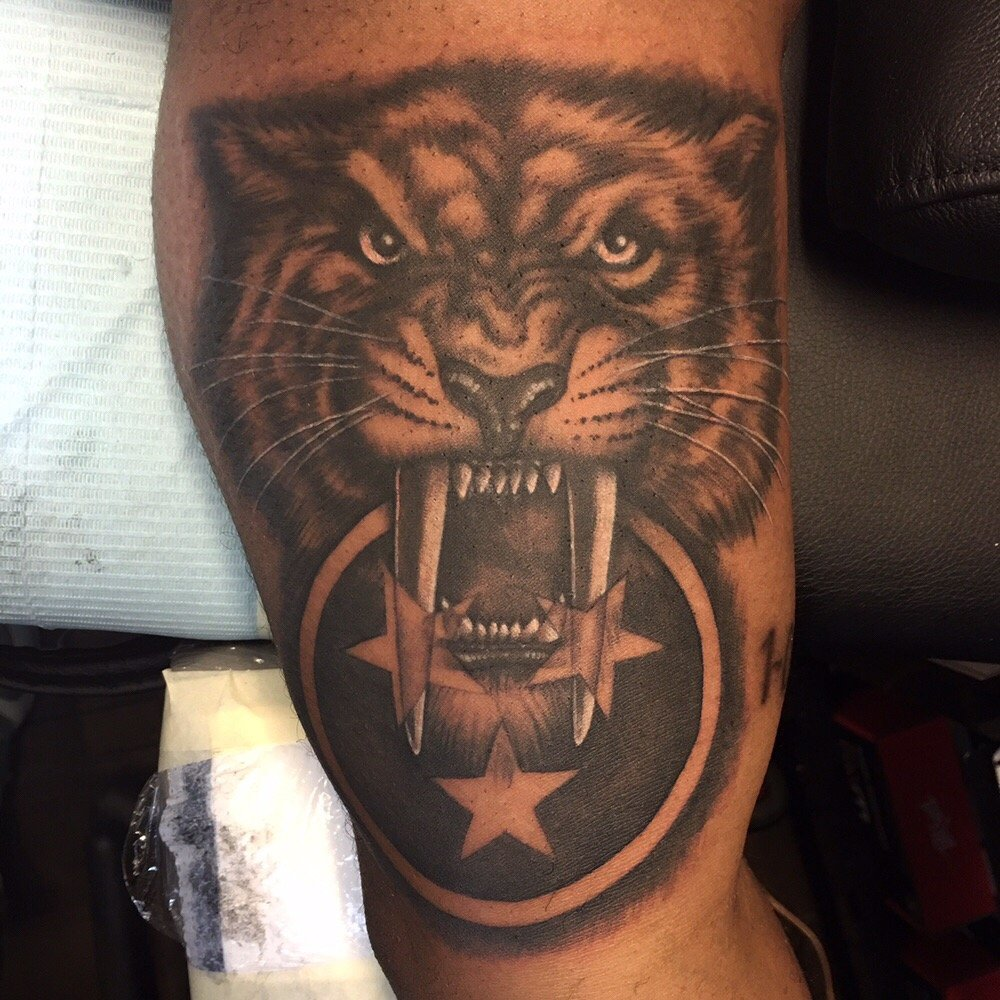 Realistic black and gray nashville predators pride tattoo for Tattoo places in nashville
