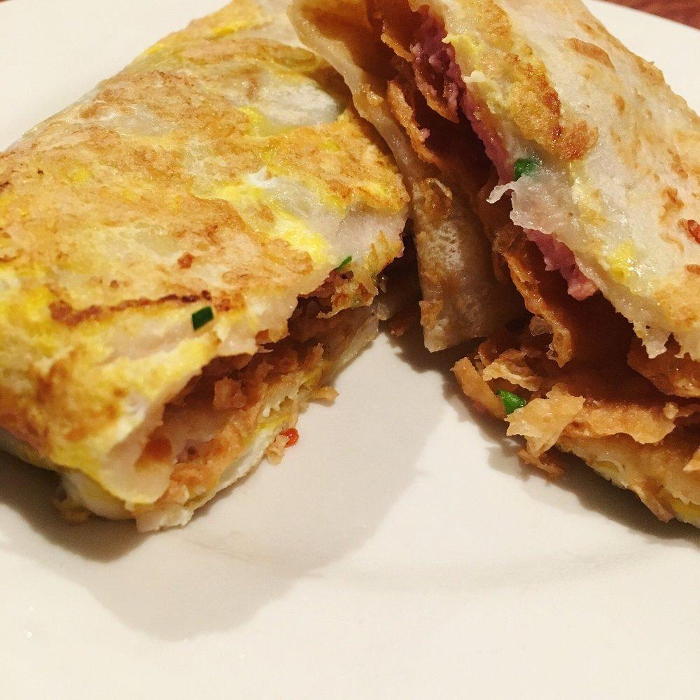 jian bing guo zi (egg wraps with lunch meat,spicial sauce,crisp ...