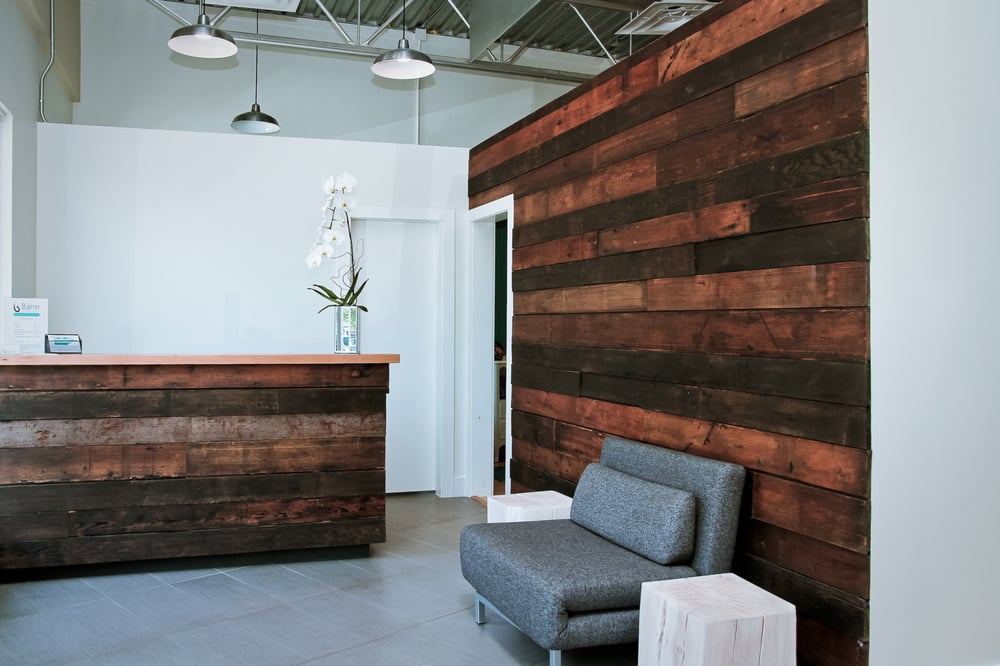 Welcoming front entrance featuring a reclaimed wood wall