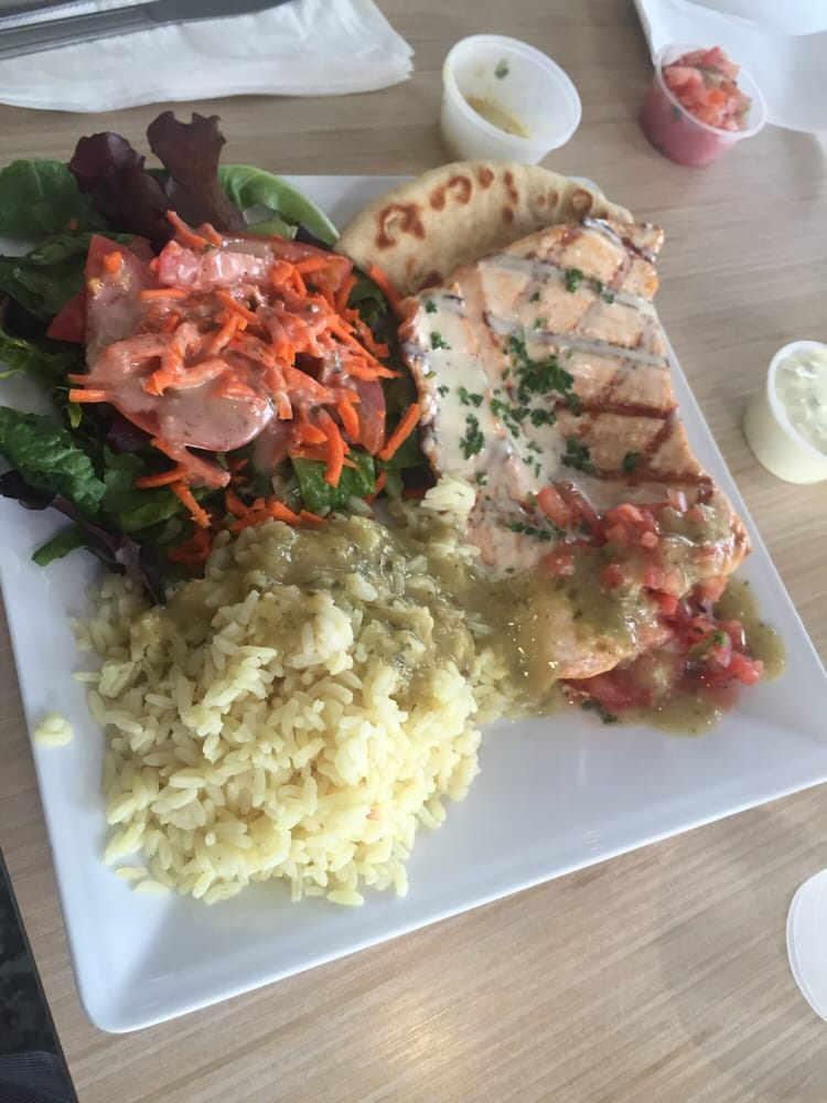 Garlic buttered salmon with garden salad and regular rice for Malibu fish grill
